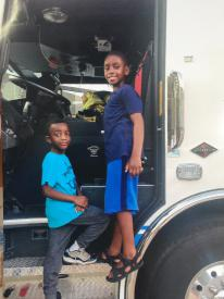 Zavion on Hughesville's Engine at National Night Out at Malcolm Elementary, 2015